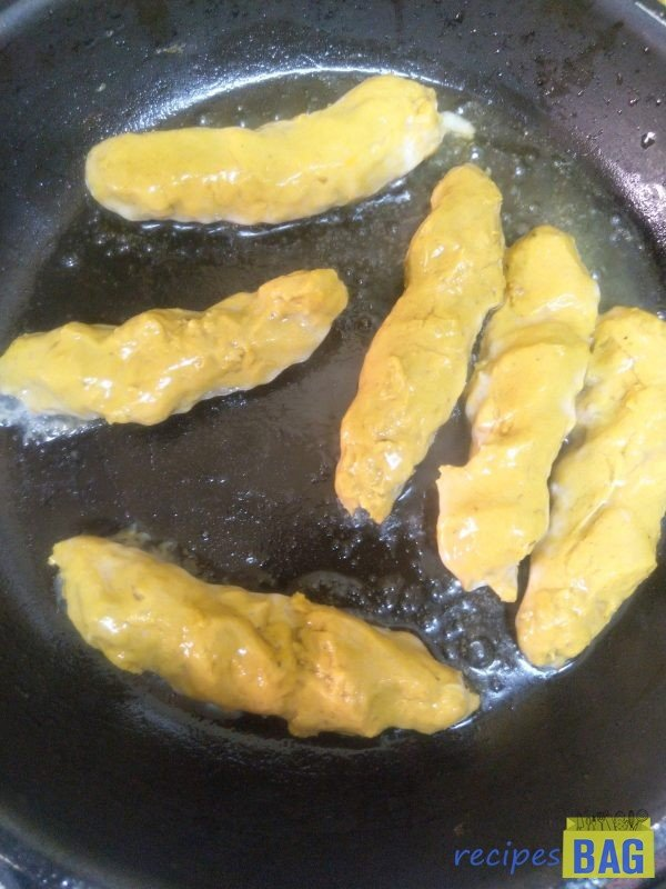 Heat about 2 tablespoon oil in a pan. Put the kebabs into oil , cover and cook on low flame for 5 minutes on each side.