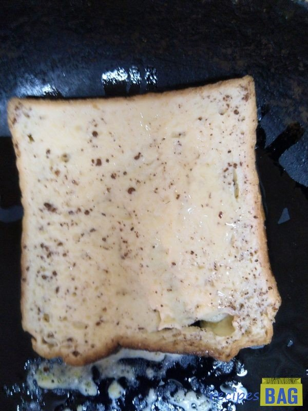 Immediately transfer the soaked bread into the pan one by one and lower the flame, cover and cook for 3 minutes each on both sides until the bread becomes nice golden brown in colour and turns crispy.