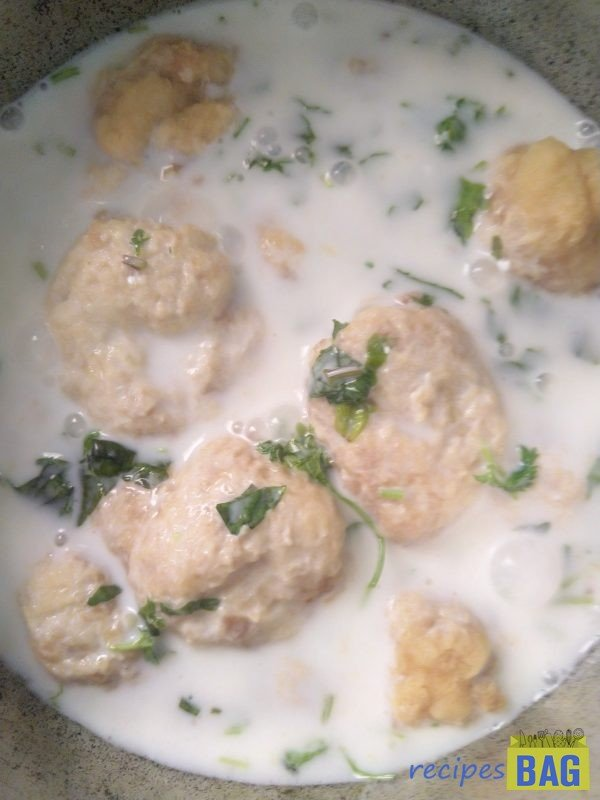 Add the already water soaked fritters  into the yogurt slurry. At this point you can either temper as shown or just add chaat masala.