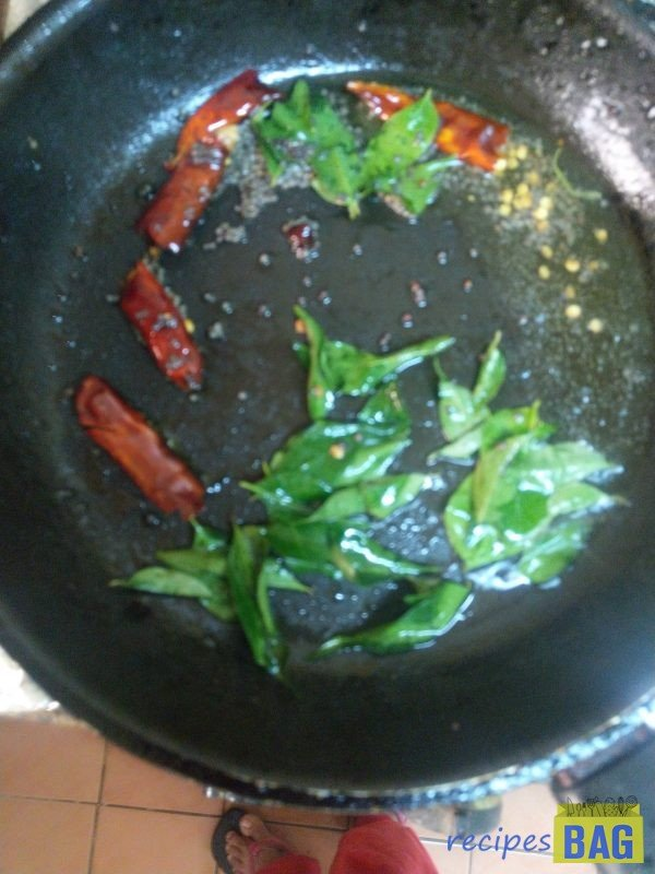Now heat oil in pan for tempering. Add mustard seeds, broken dry red chillies and curry leaves and cook until the crackling sound of spices is heard. This may take 2 minutes on high flame.
