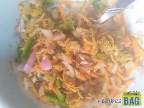 Add all the veggies and spices like onion, capsicum, carrot, black pepper powder, salt. Mix well