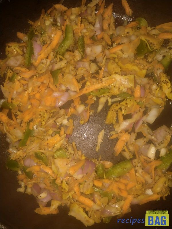 Stir fry this mixture of shredded chicken, spices and veggies for 2 minutes on high flame.