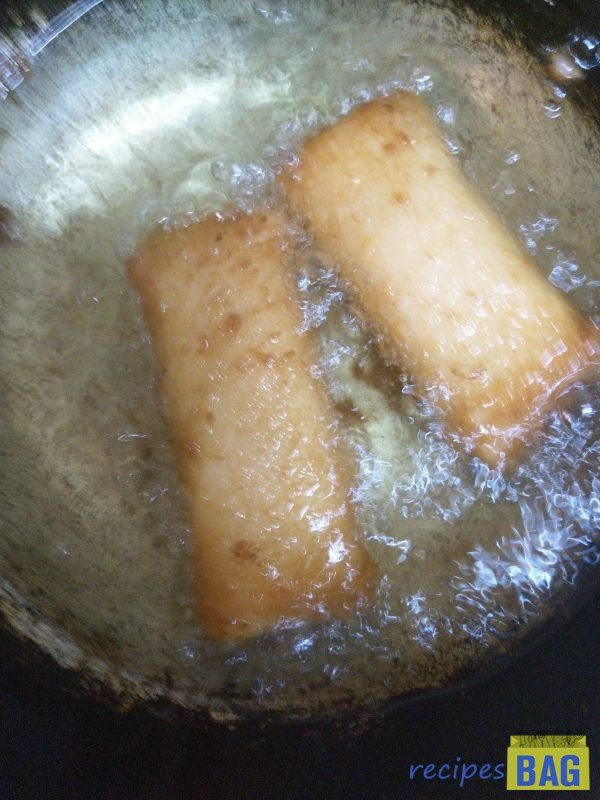 Heat oil on high flame and deep fry the made bread pockets on high flame until golden.