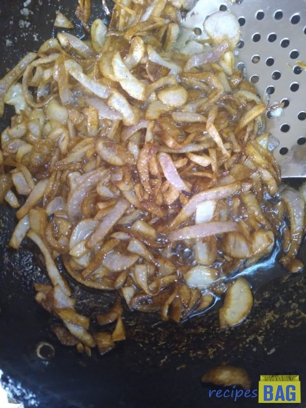 Meanwhile, heat oil in a Kadai or wok and fry the onions in 240 ml oil until they turn golden in colour. Remove from oil and keep the deep-fried onions aside.