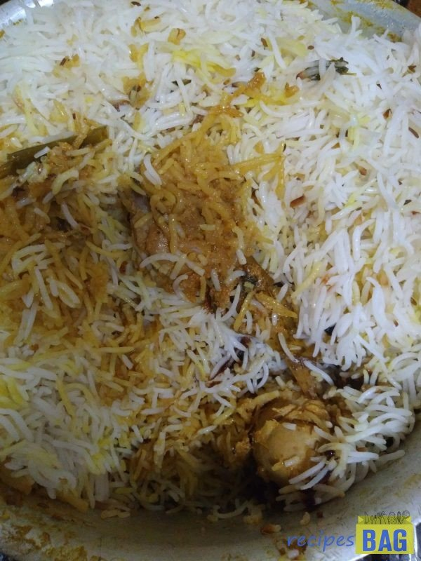 That's it. Nizami biryani is ready. Mix little by little from the sides as required and serve hot with Nizami raita.