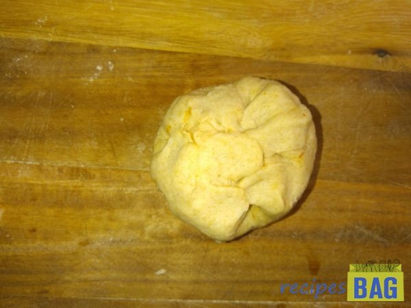 Close it from the sides making a dumpling.