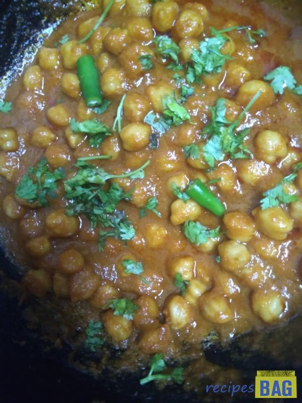 Finally add the lime juice and fresh coriander leaves. That's it chole is ready to be served.