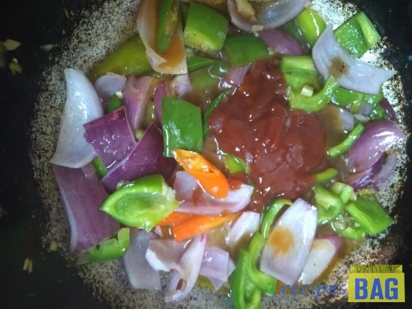 Now add all the sauces, soya sauce, tomato sauce, Red chili sauce, and mix well.