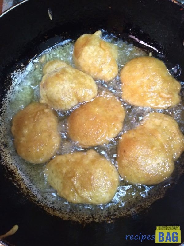 Fry until they turn golden on both sides, this may take 3-4 minutes for each batch.