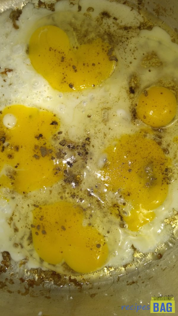 Meanwhile, heat 2 tablespoons of oil in a frying pan, and fry the eggs on medium flame with a little salt and black pepper powder.  When the eggs are half cooked scramble them into small pieces. Keep aside.