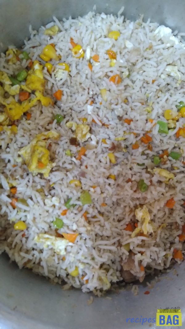 Mix well and stir fry on high flame for another 1 minute. That's it. Chicken fried rice is ready to be served.